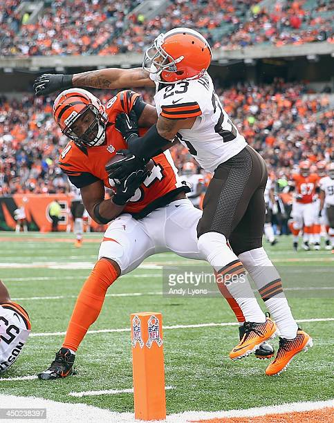 Jermaine Gresham of the Cincinnati Bengals runs for a touchdown while defended by Joe Haden of the Cleveland Browns during the game at Paul Brown...