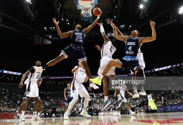 Jermaine Harris of the Rhode Island Rams shoots against Kyle Lofton of the St Bonaventure Bonnies during their Atlantic 10 basketball tournament Semi...