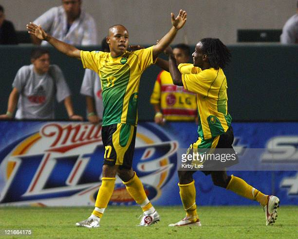 Jermaine Hue of Jamaica is congratulated by Robert Scarlett after scoring a secondhalf goal during 43 victory over Guatemala in CONCACAF Gold Cup...