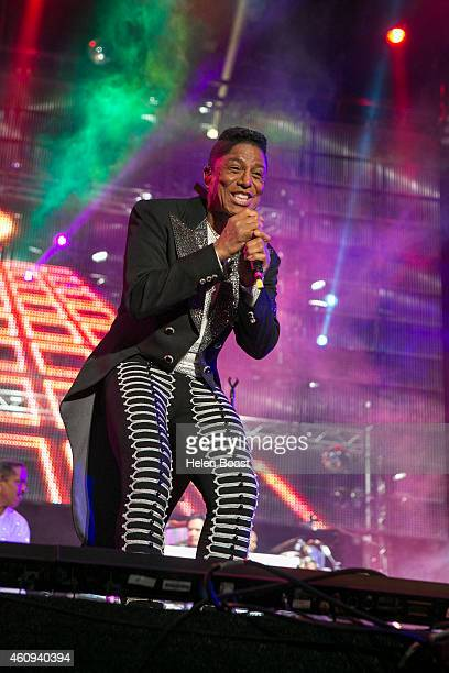 Jermaine Jackson of The Jacksons performs on stage at the New Year's Eve Masterjam at Media City Amphitheatre on December 31 2014 in Dubai United...