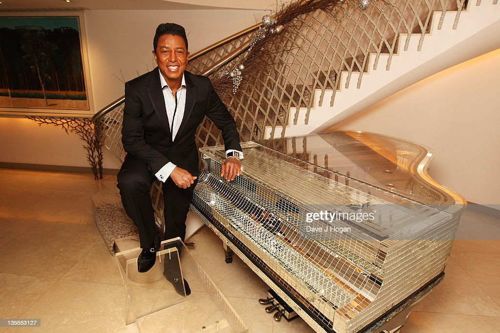 Jermaine Jackson poses for a portrait after getting fitted for a suit by Saville Row tailor Gary Anderson at The Dorchester Hotel on December 12, 2011 in London, United Kingdom.