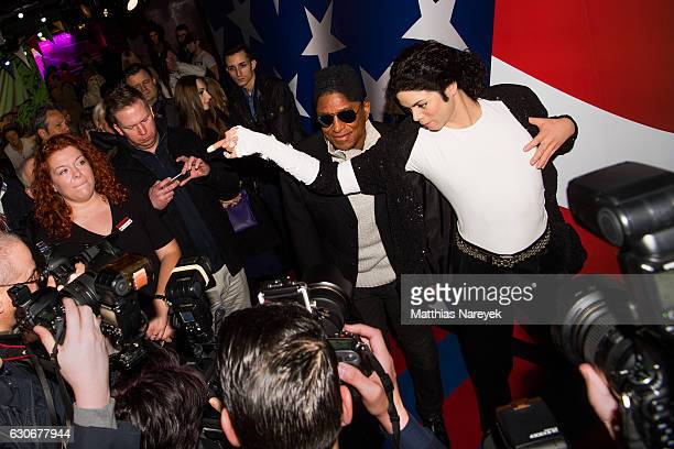 Jermaine Jackson visits the wax figure of his brother Michael Jackson at Madame Tussauds on December 30 2016 in Berlin Germany