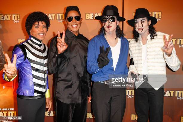 Jermaine Jackson with Dantanio Goodmann and Cast of 'BEAT IT' attend the musical premiere of 'BEAT IT Die Show ueber den King of Pop' at Stage...