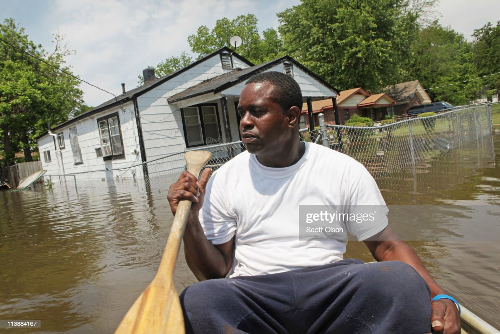 Jermaine Jarrett paddles a boat down a flooded street in his neighborhood May 9, 2011 in Memphis, Tennessee. The Mississippi River is expected to crest at Memphis tonight at 48 feet, which is about 6 inches shy of the record set during the flood of 1937. Officials estimate about 1,300 homes in the city are at risk of suffering dangerous flooding. Heavy rains have left the ground saturated, rivers swollen, and have caused widespread flooding in Missouri, Illinois, Kentucky, Tennessee, and Arkansas.