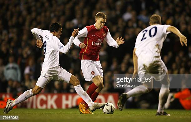 Jermaine Jenas and Michael Dawson of Tottenham challenge Nicklas Bendtner of Arsenal during the Carling Cup Semifinal second leg match between...