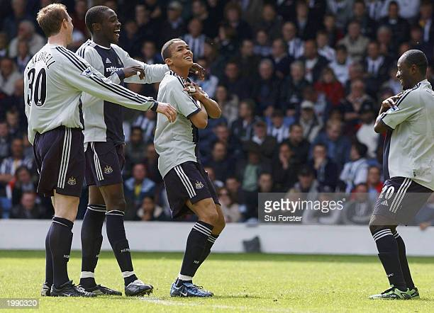 Jermaine Jenas celebrates with his team mates after scoring during the FA Barclaycard Premiership match between West Bromwich Albion and Newcastle...