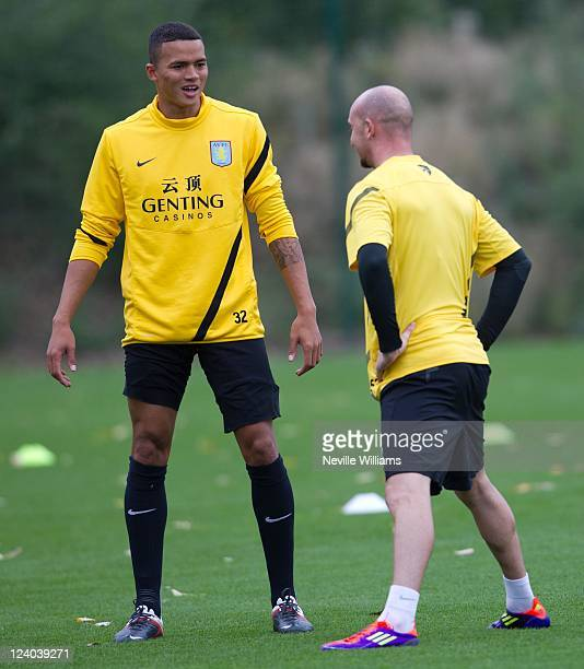 Jermaine Jenas of Aston Villa talks with Stephen Ireland during an Aston Villa training session at the club's training ground at Bodymoor Heath on...