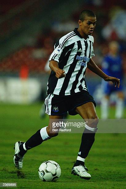 Jermaine Jenas of Newcastle United runs with the ball during the FA Premier League Asia Cup Final match between Newcastle United and Chelsea held on...