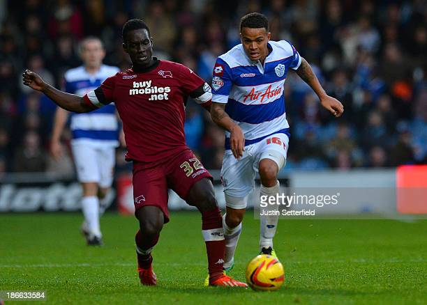 Jermaine Jenas Of Queens Park Rangers and Simon Dawkins Of Derby County in action during the Sky Bet Championship match between Queens Park Rangers...