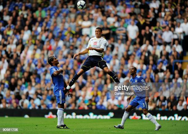 Jermaine Jenas of Spurs wins a header as Florent Malouda and Ashley Cole of Chelsea look on during the Barclays Premier League match between Chelsea...