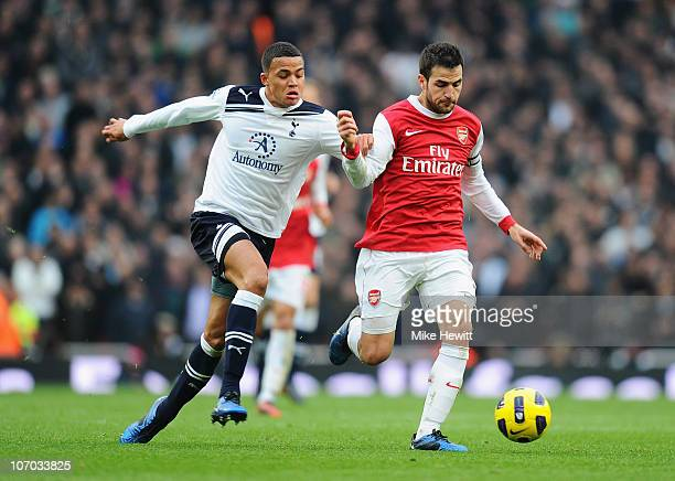 Jermaine Jenas of Tottenham challenges Cesc Fabregas of Arsenal during the Barclays Premier League match between Arsenal and Tottenham Hotspur at the...
