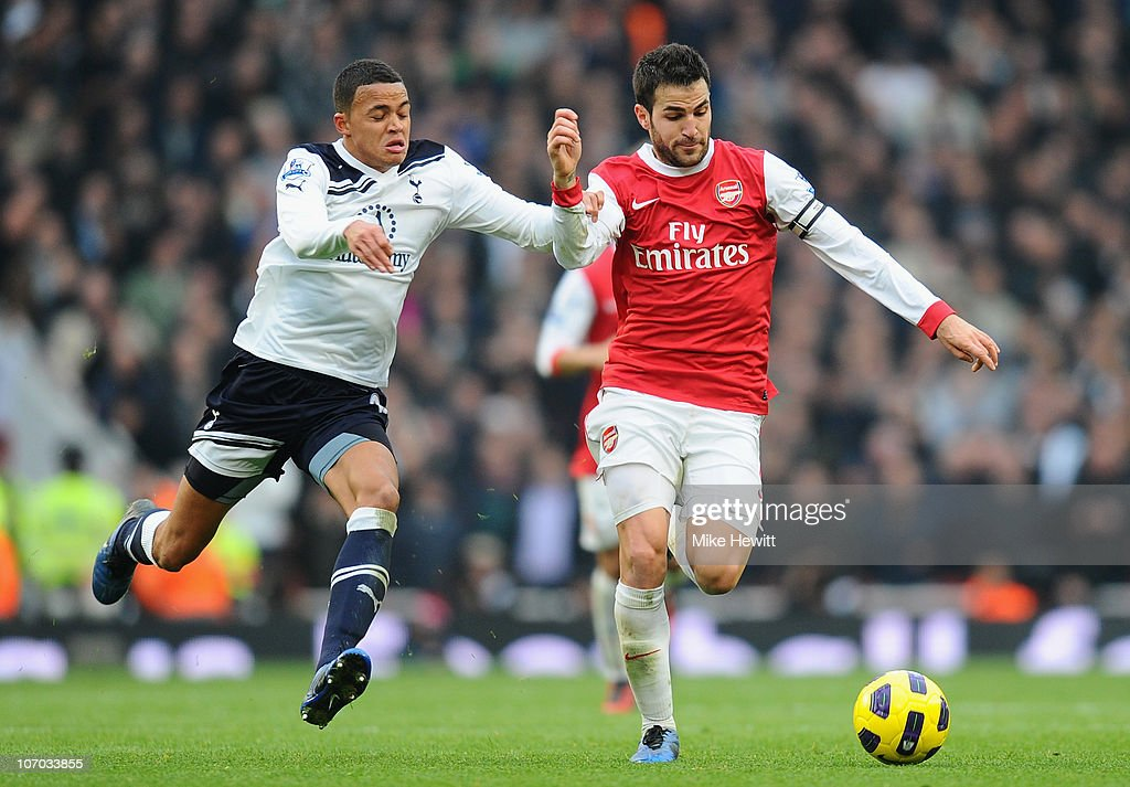 Jermaine Jenas of Tottenham challenges Cesc Fabregas of Arsenal during the Barclays Premier League match between Arsenal and Tottenham Hotspur at the Emirates Stadium on November 20, 2010 in London, England.
