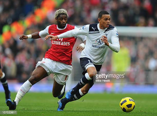Jermaine Jenas of Tottenham gets away from Alex Song of Arsenal during the Barclays Premier League match between Arsenal and Tottenham Hotspur at the...