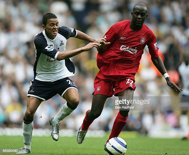 Jermaine Jenas of Tottenham Hotspur challenges Momo Sissoko of Liverpool during the Barclays Premiership match between Tottenham Hotspur and...