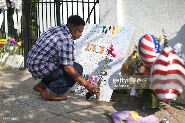 Jermaine Jenkins pays his respects in front of Emanuel African Methodist Episcopal Church after a mass shooting at the church that killed nine people...