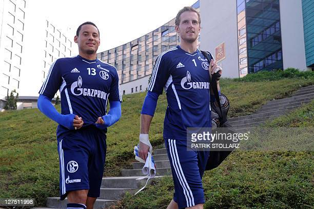 Jermaine Jones defender and goalkeeper Ralf Faehrmann of German first division football club FC Schalke 04 arrives for a training session on the eve...