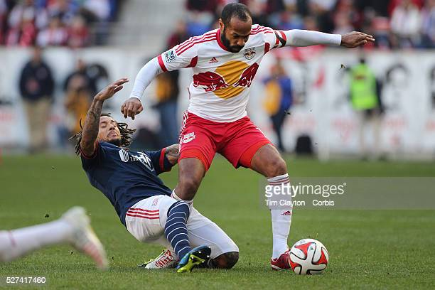 Jermaine Jones New England Revolution takes an elbow from Thierry Henry New York Red Bulls during the New York Red Bulls Vs New England Revolution...