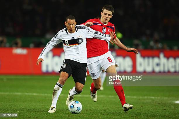 Jermaine Jones of Germany and Michael Carrick of England battle for the ball during the International Friendly match between Germany and England at...