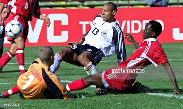 Jermaine Jones of Germany fights for the ball with Victor Oppong and the goalkeeper Pieter Meuleman of Canada 20 June 2001 during a game for the...