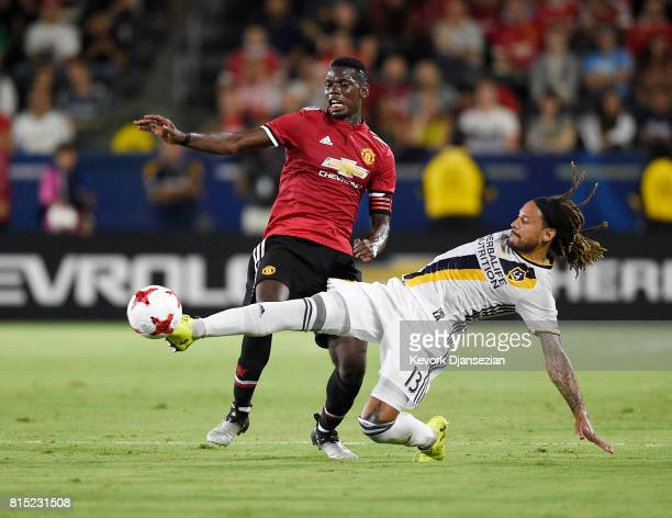 Jermaine Jones of Los Angeles Galaxy defends against Paul Pogba of Manchester United during the second half of their exhibition soccer game at the...