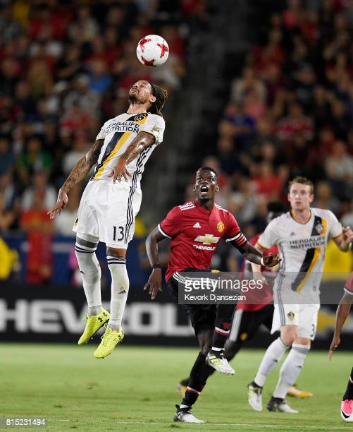 Jermaine Jones of Los Angeles Galaxy goes for a header against Paul Pogba of Manchester United during the second half of their exhibition soccer game...