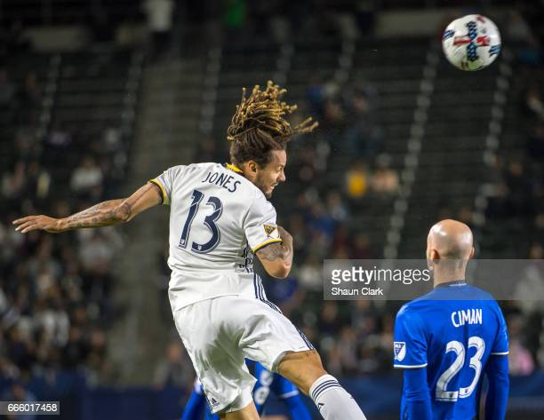 Jermaine Jones of Los Angeles Galaxy heads the ball as Laurent Ciman of Montreal Impact defends during Los Angeles Galaxy's MLS match against...