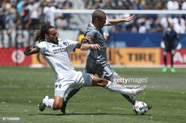 Jermaine Jones of Los Angeles Galaxy tackles Osvaldo Alonso of Seattle Sounders during the first half of their MLS match at StubHub Center on April...