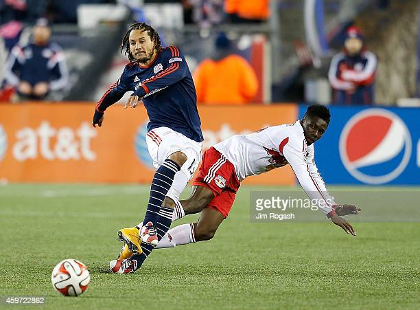 Jermaine Jones of New England Revolution defends against Ambroise Oyongo of New York Red Bulls in the second half during Leg 2 of the MLS Eastern...