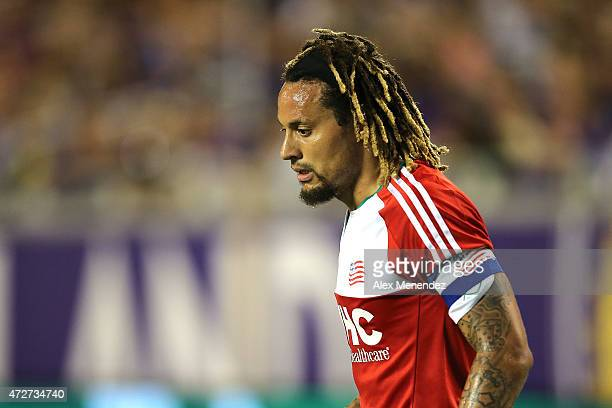 Jermaine Jones of New England Revolution looks at an injured player on the ground during an MLS soccer match between the New England Revolution and...