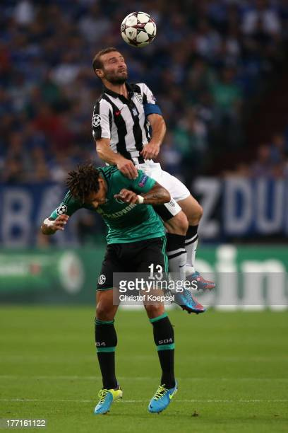 Jermaine Jones of Schalke and Dimitris Salpingidis of Saloniki go up for a header during the UEFA Champions League Playoff first leg match between FC...