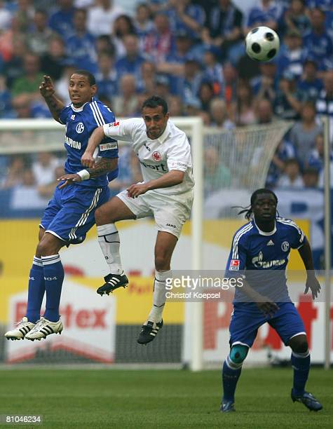 Jermaine Jones of Schalke and Markus Weissenberger of Frankfurt go up for a header during the Bundesliga match between Schalke 04 and Eintracht...