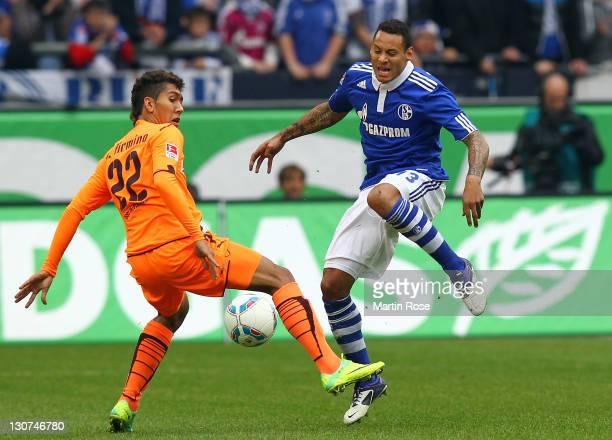 Jermaine Jones of Schalke and Roberto Firmino of Hoffenheim battle for the ball during the Bundesliga match between FC Schalke 04 and 1899 Hoffenheim...