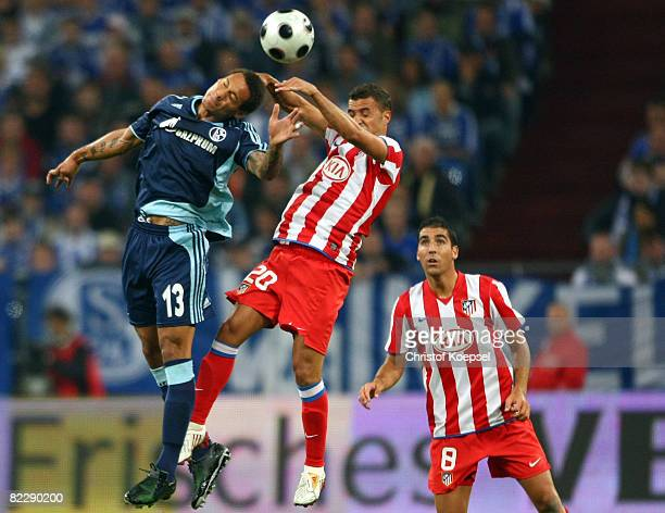 Jermaine Jones of Schalke and Simao of Atletico go up for a header during the UEFA Champions League 3rd Qualifying Round match between FC Schalke and...