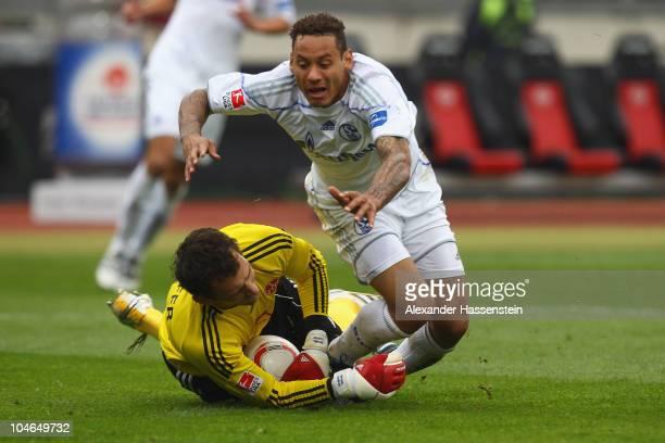Jermaine Jones of Schalke battles for the ball with Nuernberg's keeper Raphael Schaefer during the Bundesliga match between 1 FC Nuernberg and FC...