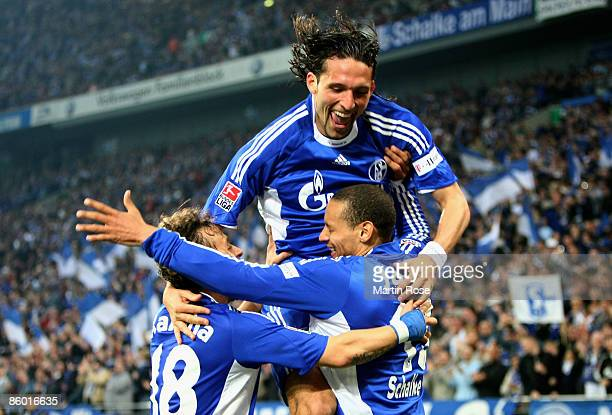 Jermaine Jones of Schalke celebrate with his team mates Rafinha and Kevin Kuranyi after he scores his teams 3rd goal during the Bundesliga match...