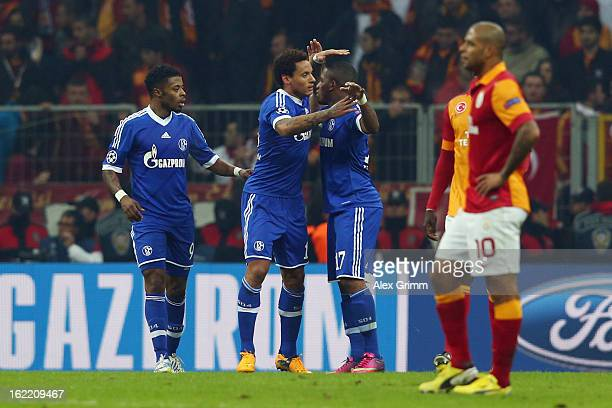 Jermaine Jones of Schalke celebrates his team's first goal with team mates during the UEFA Champions League Round of 16 first leg match between...