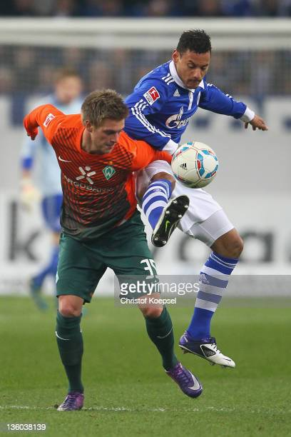 Jermaine Jones of Schalke challenges Florian Trinks of Bremen during the Bundesliga match between FC Schalke 04 and SV Werder Bremen at Veltins Arena...