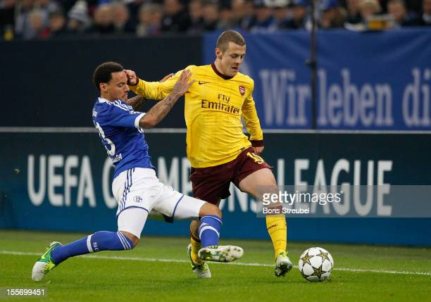 Jermaine Jones of Schalke challenges Jack Wilshere of Arsenal during the UEFA Champions League group B match between FC Schalke 04 and Arsenal FC at...