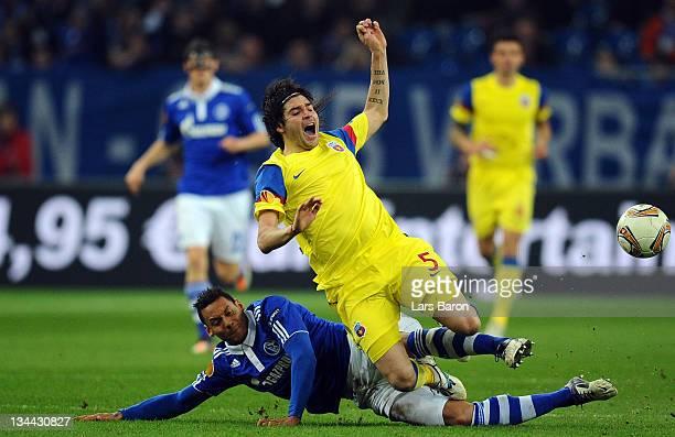 Jermaine Jones of Schalke challenges Pablo Brandan of Steaua during the UEFA Europa League group J match between FC Schalke 04 and FC Steaua...