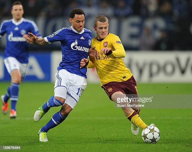 Jermaine Jones of Schalke competes for the ball with Jack Wilshere of Arsenal during the UEFA Champions League Group B match between FC Schalke 04...