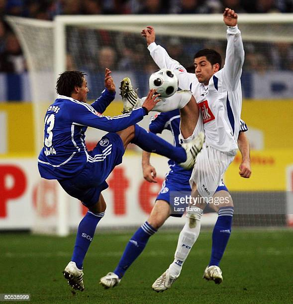 Jermaine Jones of Schalke in action with Amir Shapourzadeh of Rostock during the Bundesliga match between Schalke 04 and Hansa Rostock at the Veltins...