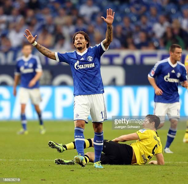 Jermaine Jones of Schalke reacts after fouling Robert Lewandowski of Dortmund during the Bundesliga match between Schalke 04 and Borussia Dortmund at...