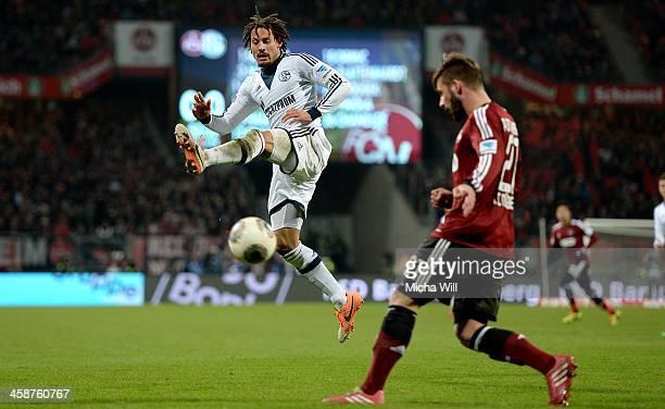 Jermaine Jones of Schalke tries to block a kick of Marvin Plattenhardt of Nuernberg during the Bundesliga match between 1 FC Nuernberg and FC Schalke...