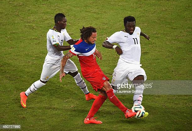 Jermaine Jones of the United States and Sulley Muntari of Ghana battle for the ball during the 2014 FIFA World Cup Brazil Group G match between Ghana...