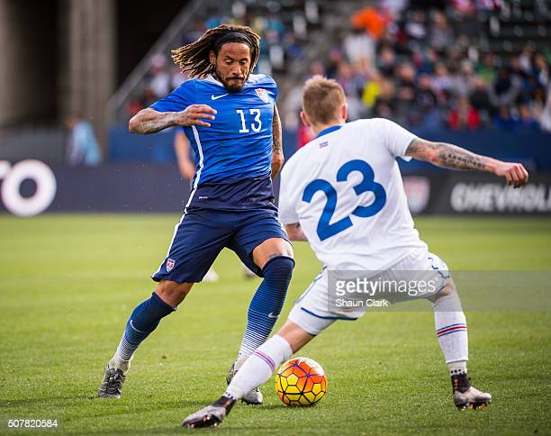 Jermaine Jones of the United States charges upfield as Ari Freyr Skulason of Iceland defends during the International Soccer Friendly match between...