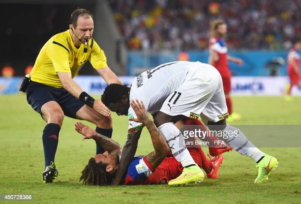 Jermaine Jones of the United States confronts Sulley Muntari of Ghana during the 2014 FIFA World Cup Brazil Group G match between Ghana and USA at...