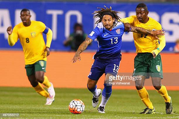 Jermaine Jones of the United States fends off Seinard Bowens of St Vincent and the Grenadines while controlling the ball during a World Cup...