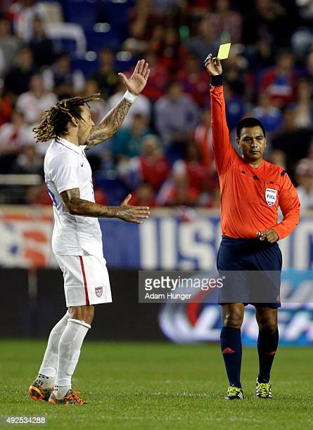 Jermaine Jones of the United States reacts to being issued a yellow card by referee Walter Lopez against Costa Rica during the first half at Red Bull...
