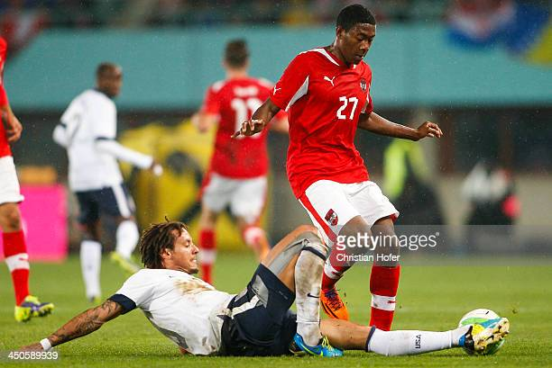 Jermaine Jones of USA tackles David Alaba of Austria during the International friendly match between Austria and USA at the Ernst-Happel Stadium on...