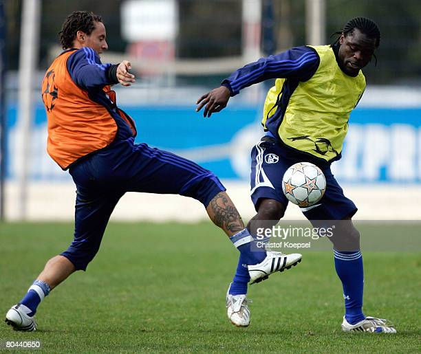 Jermaine Jones tackles Gerald Asamoah during the training session of FC Schalke at the training ground at the Veltins Arena on March 31, 2008 in...